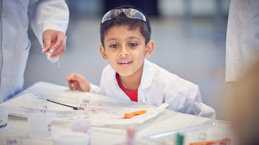 A student in the Crick's teaching lab at Discovery Day 2019.