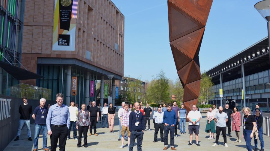 Members of the COVID-19 Consortium outside the Crick, standing 2 meters apart.