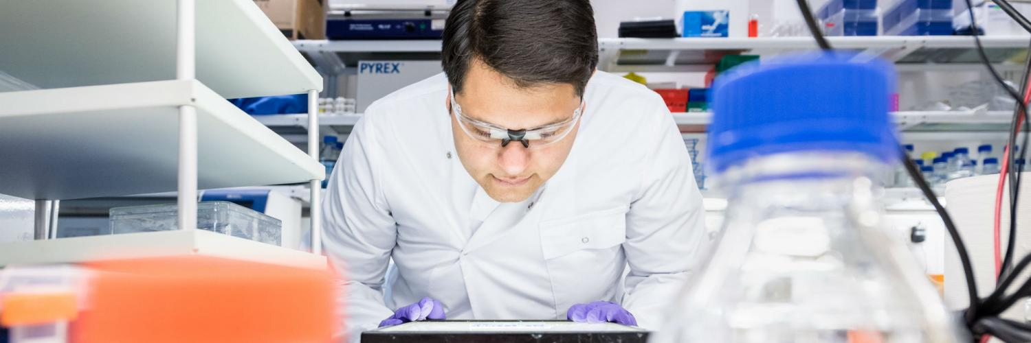 Researcher at a lab bench
