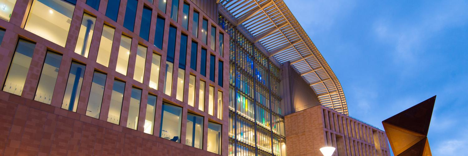 Exterior of the Francis Crick Institute at night.