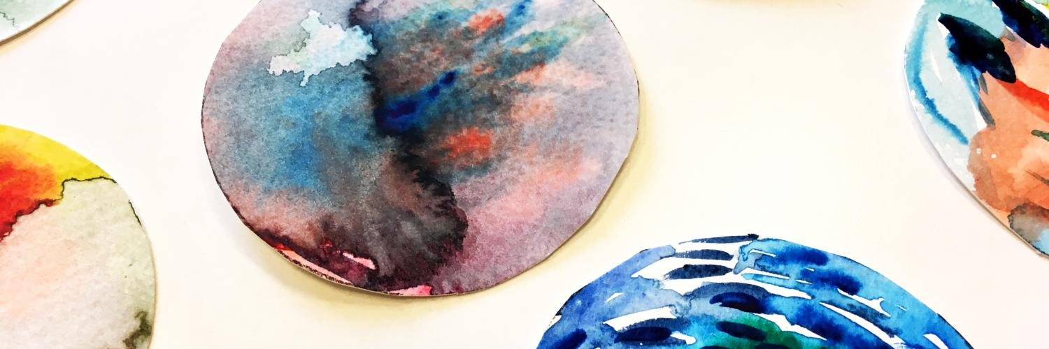 Coloured circular artworks on a table