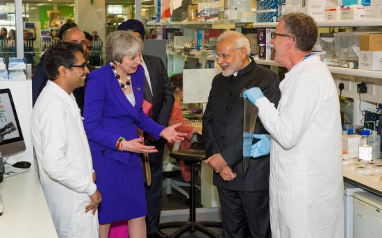 Raju Veeriah (left) meets Prime Ministers Theresa May and Narendra Modi.