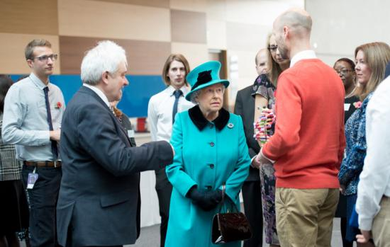 The Queen meeting Crick staff at the official opening.
