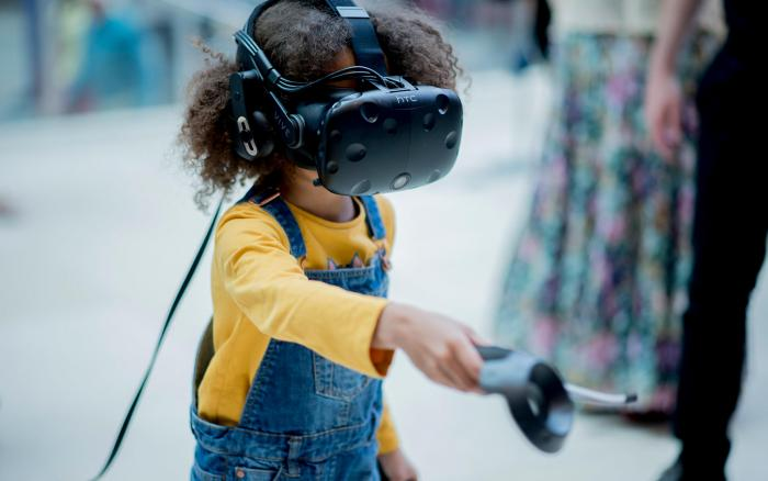 A child using a virtual reality headset at a discovery day at the Crick.